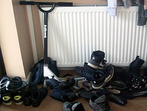 "I didn't take a ""before"" picture, but this random photo from the internet gives a rough idea our old shoe ""organization method"""